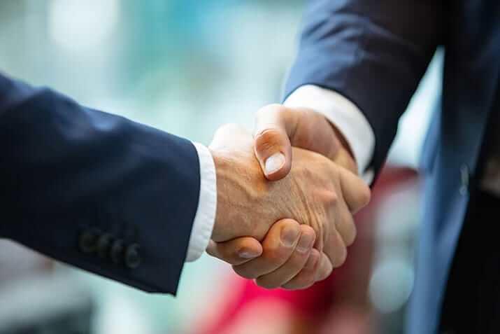 Fernandez Firm Attorney Client Handshake